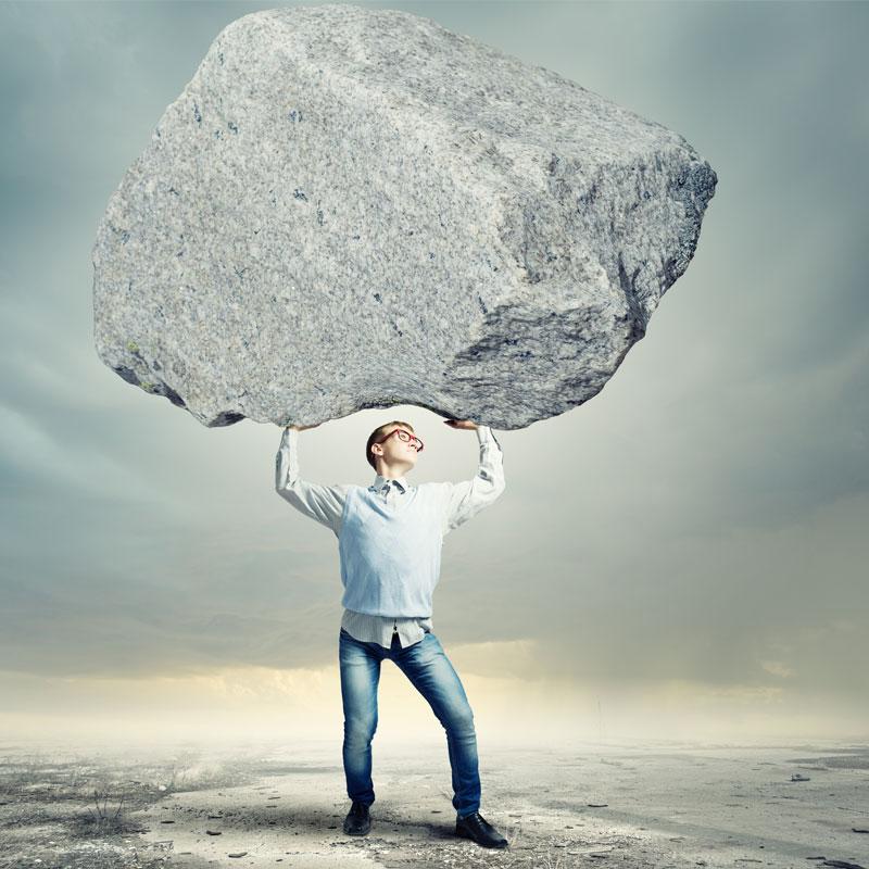 Man Lifting Heavy Rock