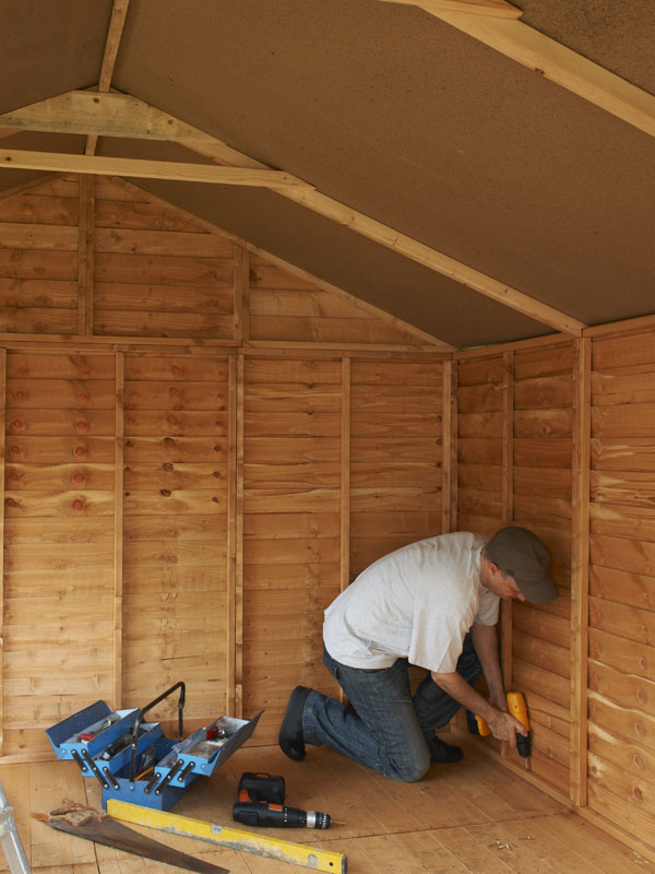 Man Building A garden Shed In Walthamstow